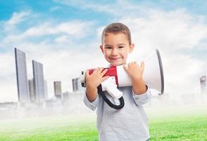 portrait of a little boy holding a megaphone